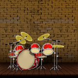 Old brick wall and wooden floor and drum kit Stock Photos