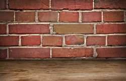 Old brick wall and wooden flor Stock Photo