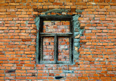 Old brick wall with wooden window Royalty Free Stock Photos