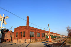 Old brick warehouse along the tracks Stock Image