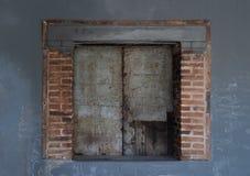 Old brick window on blue background stock photo