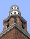 Old brick and wood tiered tower. Stock Images