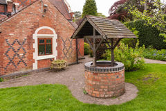 Old bricked well. Old, bricked well in a garden Stock Photography
