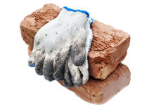 Old bricks and gloves. Construction materials - old bricks and gloves Royalty Free Stock Photography