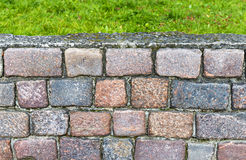 Old bricks with green grass Royalty Free Stock Photos