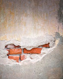 Old bricks wall with cracked stucco layer Stock Photos