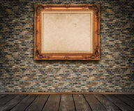 Old bricks wall and old-fashioned wooden frame. Stock Image
