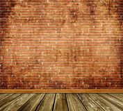 Old bricks wall and wooden floor background. Stock Images