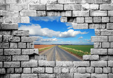 Old brickwall with country road Royalty Free Stock Photos