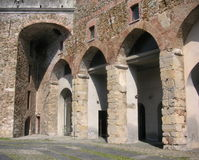 Old brickwork arcades of the fort in Savona Stock Photos