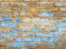 Old brickwork, blurred by the weather, the blue and yellow colored wall. Royalty Free Stock Photos