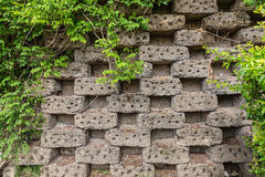 Old brickwork in a checkerboard pattern with gaps. Climbing plan stock image