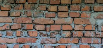 Old brickwork. Wide background. Old brickwork. Brick wall with slots, damage and mortar stock images