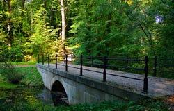 Old Bridge. Stone bridge over the pond on the estate of Duke Maximilian Leuchtenbergsky. St. Petersburg Stock Photo