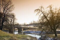 Old bridge. Of stone with arches over a flow Stock Image