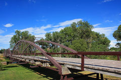 Old Bridge. The Old Red Bridge in Fort Laramie, Wyoming crossing the Platte River stock photo