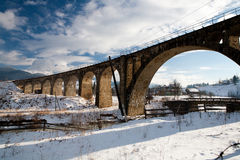 Old bridge. The winter arched old bridge Royalty Free Stock Image