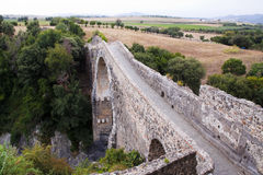 Old bridge. Medieval bridge located in Italy Royalty Free Stock Photography
