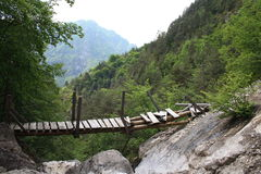 Old bridge. Mountaineering over a broken bridge Royalty Free Stock Images
