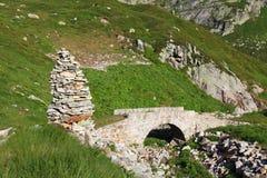 Old bridge. Cairn near the old bridge on a mountain trail Royalty Free Stock Photos