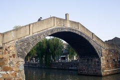 Old bridge. A very old stone arch bridge Stock Images
