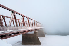 The old bridge. Kind on the bridge through the river in foggy morning Royalty Free Stock Photo