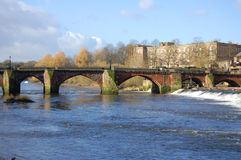 Old Bridge. Sandstone arched bridge which crosses the River Dee from the Roman City of Chester to Handbridge Royalty Free Stock Image