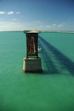 Old bridge. An old bridge surrounded by emerald green ocean. Nice blue sky. Florida Stock Photography