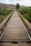 Old bridge across river Jordan Royalty Free Stock Photo
