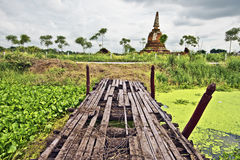 Old bridge across the river next by Ayutthaya floating market Royalty Free Stock Photography