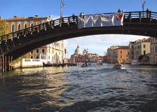 Old bridge against the Venetian style architectures along the Grand canal Royalty Free Stock Image