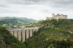 The old bridge aqueduct Ponte delle Torri and the medieval fortress Rocca Albornoziana. Spoleto, Umbria, Italy. Landscape with the old bridge aqueduct Ponte Stock Image