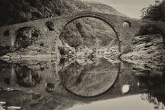 Old bridge. Beautiful old bridge with water reflection Stock Photography