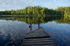 Old bridge on the bog lake. Royalty Free Stock Images