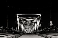 The old bridge in Bratislava is lit at night Royalty Free Stock Photo