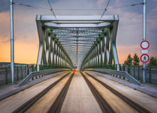 Old Bridge in Bratislava, Slovakia. Perspective View of Old Bridge with Approaching Tram in Bratislava, Slovakia at Sunset Royalty Free Stock Photo