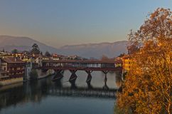 Old bridge and Brenta river in Bassano del Grappa. A panoramic view of the Old bridge over the Brenta river in Bassano del Grappa at sunset Stock Photography