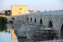 The Old Bridge in Córdoba. The Roman Bridge of Cordoba is located on the Guadalquivir River and connects the neighborhood of Campo de la Verdad with Barrio de Stock Image