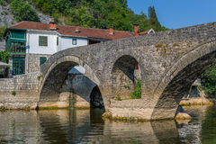 Old bridge of the Cernojevica river. The old town of Rijeka Crnojevica and medieval stone arch bridge. Touristic attraction of Skadar lake national park and Stock Image