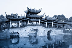 Old bridge in chinese traditional garden Stock Images