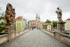 Old bridge with cobblestones and sculptures of saints in old town of Bohemia Royalty Free Stock Images