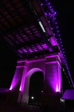 Old bridge column highlighted in purple by night Stock Image