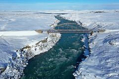 The old bridge crossing the river Tjorsa the longest river in Iceland.