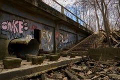 Bridge in woods with graffiti stock images