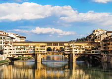The old bridge. The famous old bridge in Florence which is reflected in the river Arno in Florence gives life to a striking image Royalty Free Stock Image
