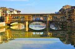 The Old bridge in Florence, Italy. River Arno in Florence Italy with the old bridge called Ponte Vecchio , a landmark in the city center stock photo