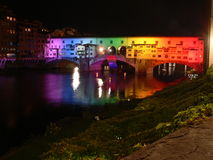Old bridge in florence by night. Illuminated by colored lights Stock Photos