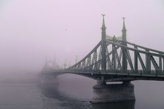 Old bridge in the fog. Mystical vision. Europe stock images