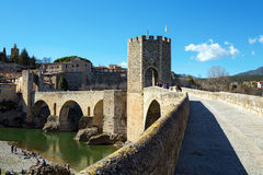 Old bridge and Fortress. Besalu, Spain. Old romanesque fortress and bridge over the Fluvià river. Besalu, Spain Stock Photography