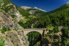 Old bridge in French Alps near Briancon, France Stock Photos